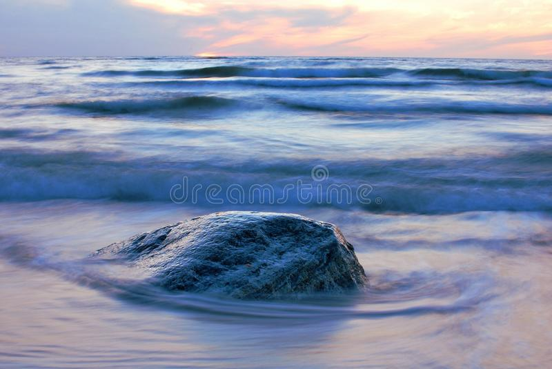 Sunset. The sunset on the beach - romantic place royalty free stock photography