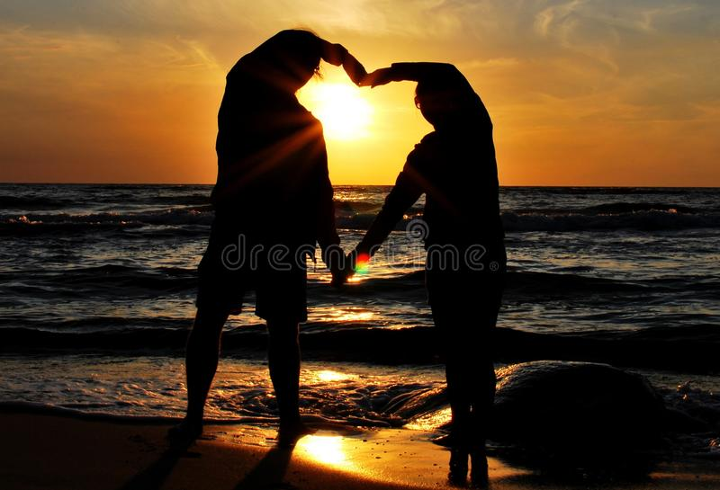 Sunset. The sunset on the beach - romantic place with lovers royalty free stock photos