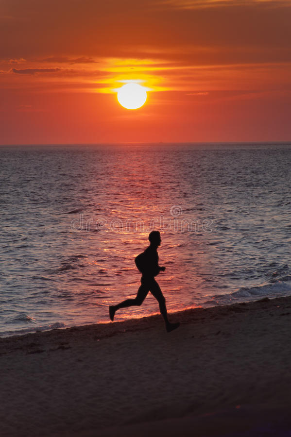 Download Sunset Beach Runner Royalty Free Stock Photography - Image: 25573437