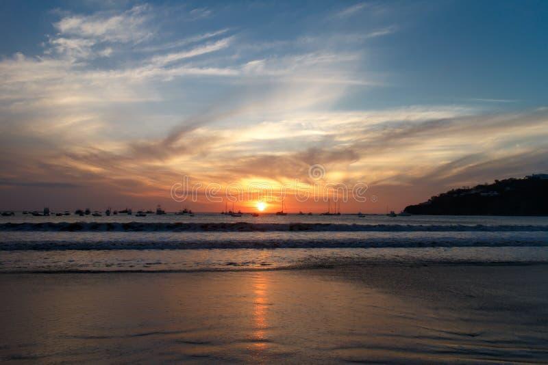 Sunset on beach, San Juan del Sur, Nicaragua. Sunset on beach from San Juan del Sur, Nicaragua royalty free stock image
