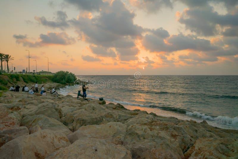 Sunset beach scene in Haifa stock images
