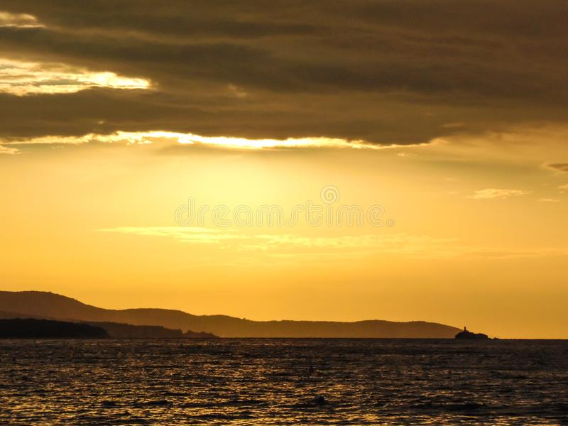 Sunset on the beach. Sunset on the shore of Ksamil, Albania. Blurred- image, water, beach, sky, sea, travel, lighthouse, ocean, landscape, coast, nature, blue royalty free stock image