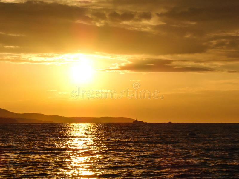 Sunset on the beach. Sunset on the shore of Ksamil, Albania. Blurred- image, water, beach, sky, sea, travel, lighthouse, ocean, landscape, coast, nature, blue royalty free stock images