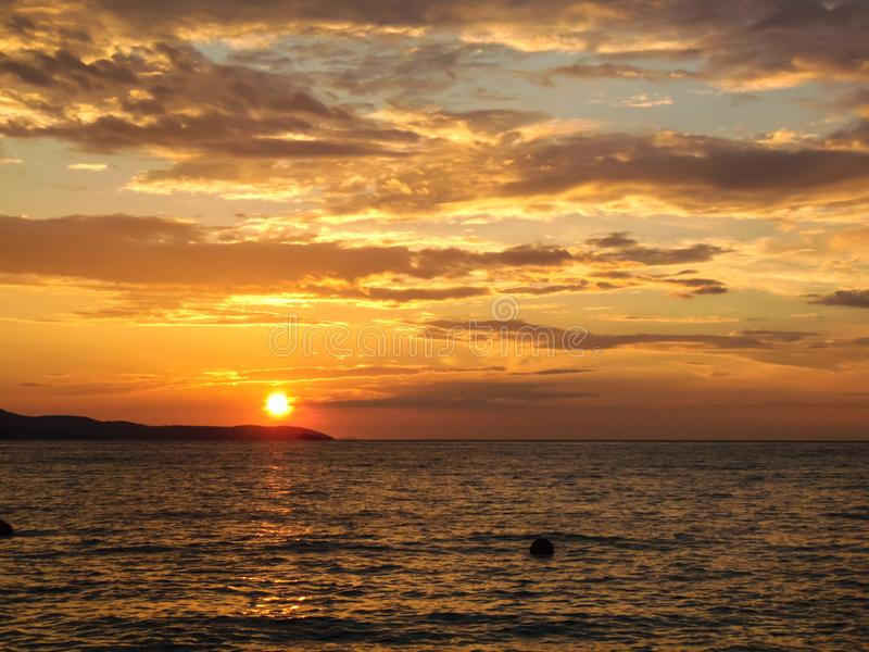 Sunset on the beach. Sunset on the shore of Ksamil, Albania. Blurred- image, water, beach, sky, sea, travel, lighthouse, ocean, landscape, coast, nature, blue royalty free stock photography