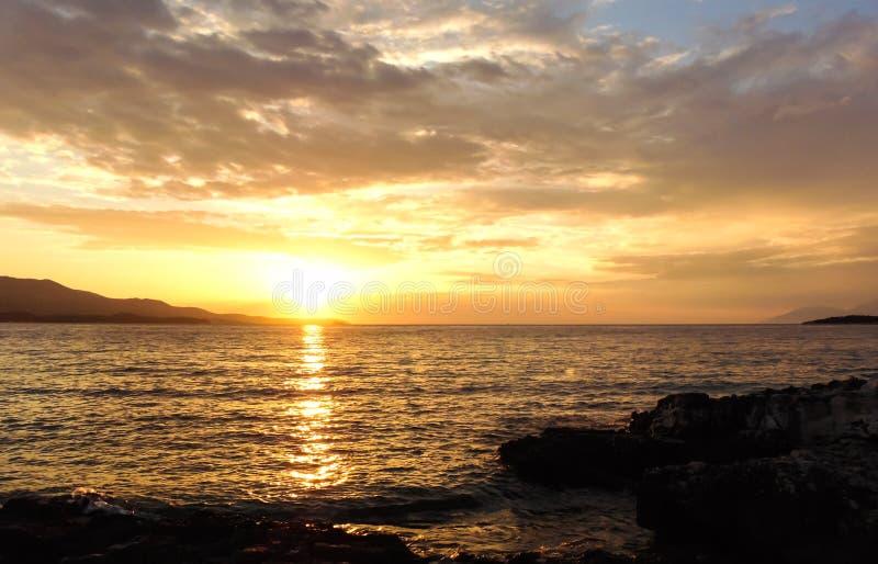 Sunset on the beach. Sunset on the shore of Ksamil, Albania. Blurred- image, water, beach, sky, sea, travel, lighthouse, ocean, landscape, coast, nature, blue stock photos