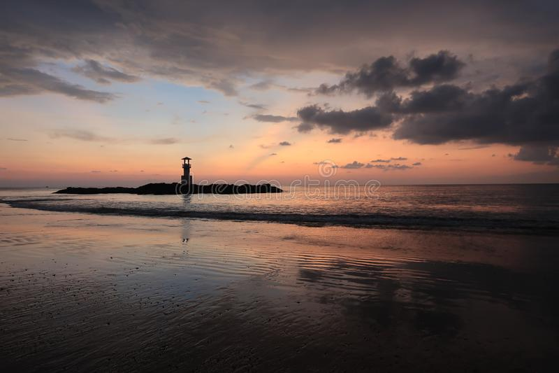Sunset on the beach with a small island of lighthouse  in Phang Nga, Thailand. Sunset on the beach with a small island of lighthouse in Phang Nga, Thailand royalty free stock images