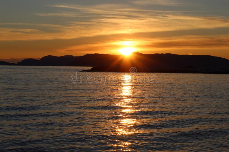 A nice afternoon at the beach with a view to the sunset in Tuscany, Italy. The sunset at the beach on a spring day in Italy. The sun was shining on this royalty free stock photography
