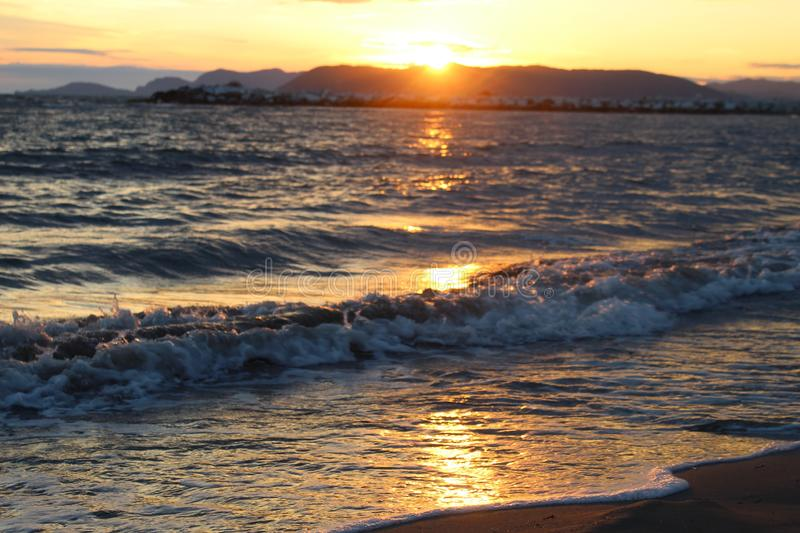 A nice afternoon at the beach with a view to the sunset in Tuscany, Italy. The sunset at the beach on a spring day in Italy. The sun was shining on this stock photos