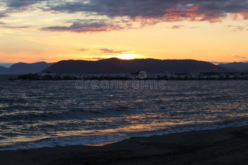 A nice afternoon at the beach with a view to the sunset in Tuscany, Italy. The sunset at the beach on a spring day in Italy. The sun was shining on this stock image