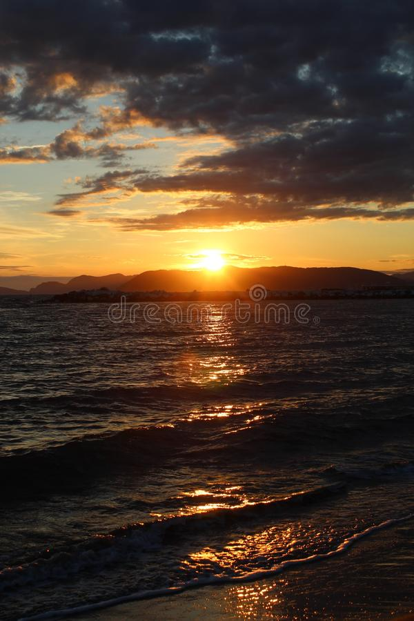 A nice afternoon at the beach with a view to the sunset in Tuscany, Italy. The sunset at the beach on a spring day in Italy. The sun was shining on this royalty free stock photo