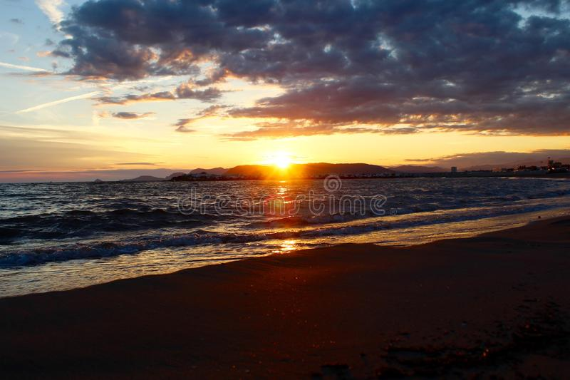 A nice afternoon at the beach with a view to the sunset in Tuscany, Italy. The sunset at the beach on a spring day in Italy. The sun was shining on this stock images
