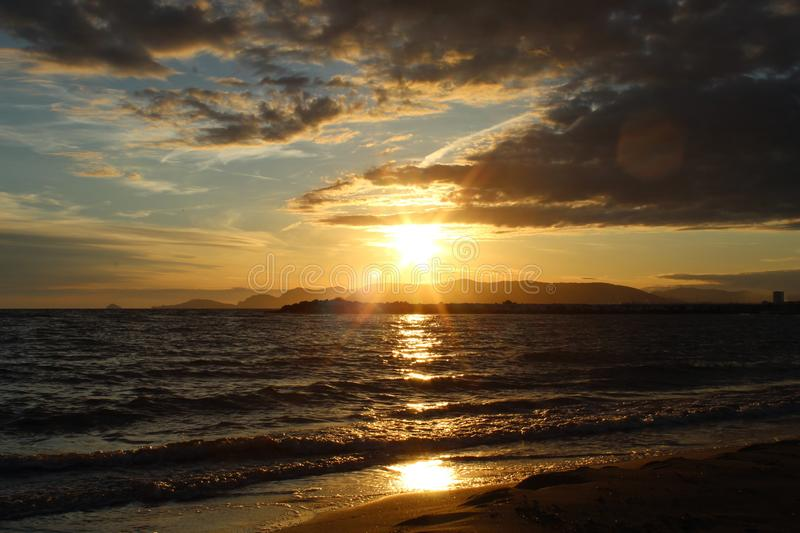 A nice afternoon at the beach with a view to the sunset in Tuscany, Italy. The sunset at the beach on a spring day in Italy. The sun was shining on this stock photography