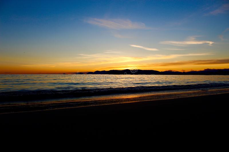 A nice afternoon at the beach with a view to the sunset in Tuscany, Italy. The sunset at the beach on a spring day in Italy. The sun was shining on this stock photo