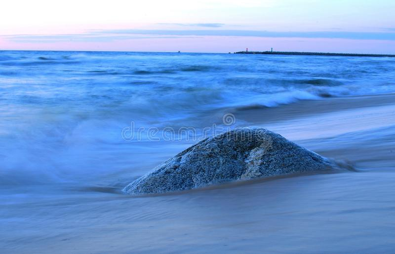 Sunset. The sunset on the beach - stone in evening scenery royalty free stock images