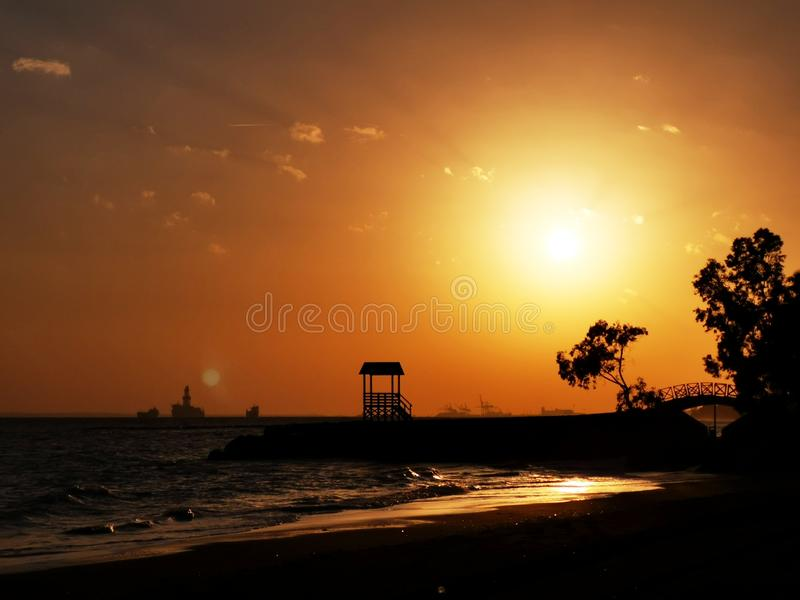 Sunset on the beach. Sunset beach seaside sky tree waves neture nature landscape royalty free stock photo