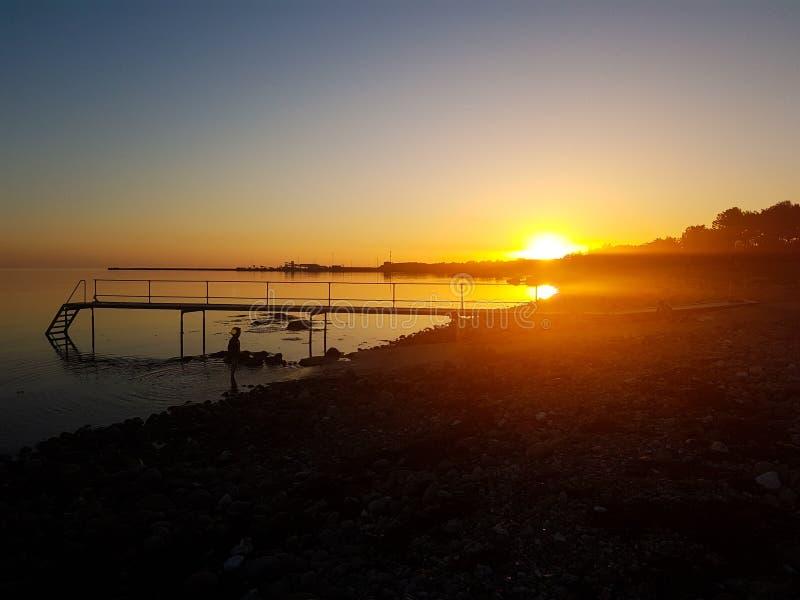 Sunset by the beach stock photos