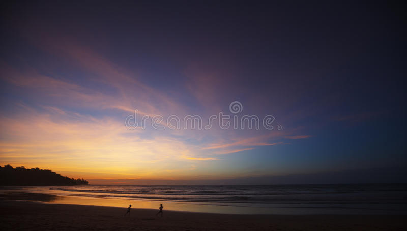 Sunset on the beach stock photography
