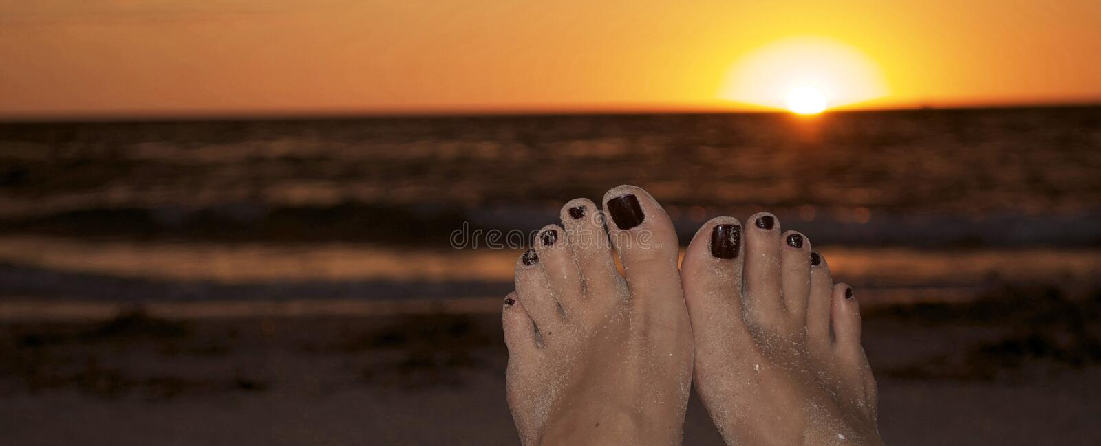Download Relaxing on the beach stock image. Image of toes, yellow - 34635627