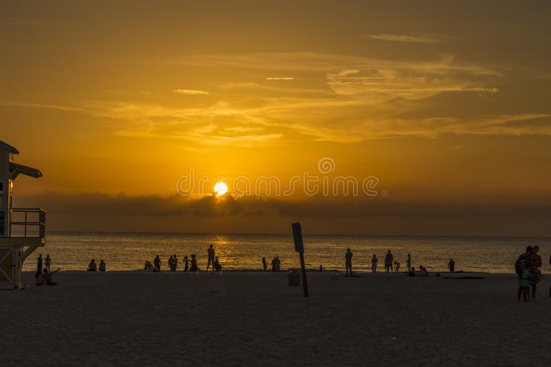 Sunset at Clearwater beach Florida. Sunset at the beautiful clearwater beach showing revellers and lifeguard tower stock photography
