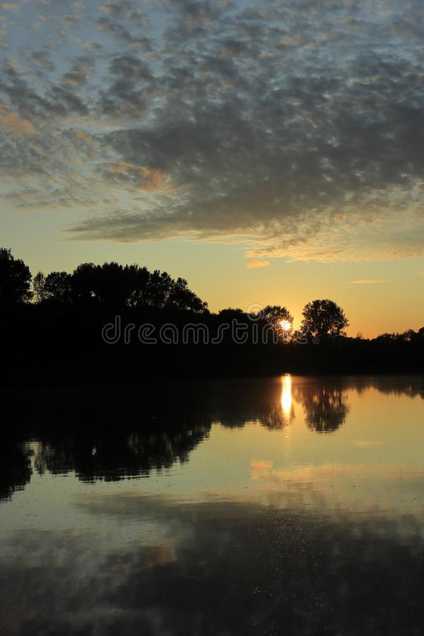 Sunset with beautiful cloud formations royalty free stock images
