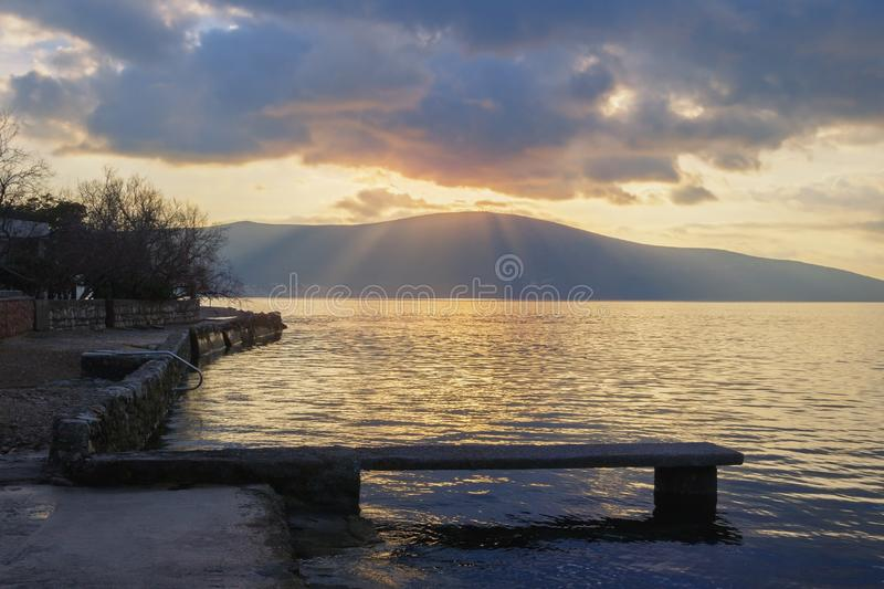 Sunset. Beautiful evening landscape with rays of light through clouds. Montenegro. Sunset. Beautiful evening landscape with rays of light through the clouds royalty free stock photos