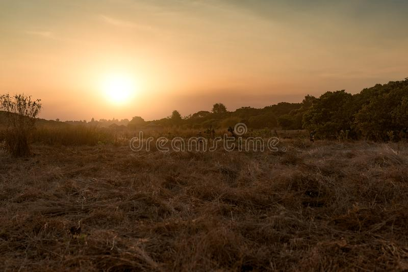 Sunset with beautiful meadow in the background in Banlung royalty free stock photography