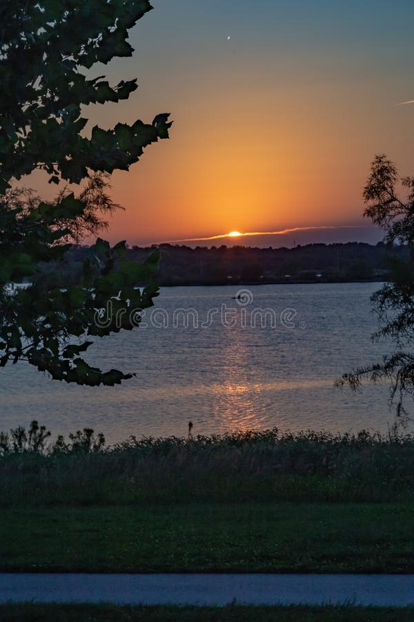Sunset with beautiful skyline over lake Zorinsky Omaha Nebraska. Sunset with beautiful skyline over lake Zorinsky taken with a neutral density filter stock photo