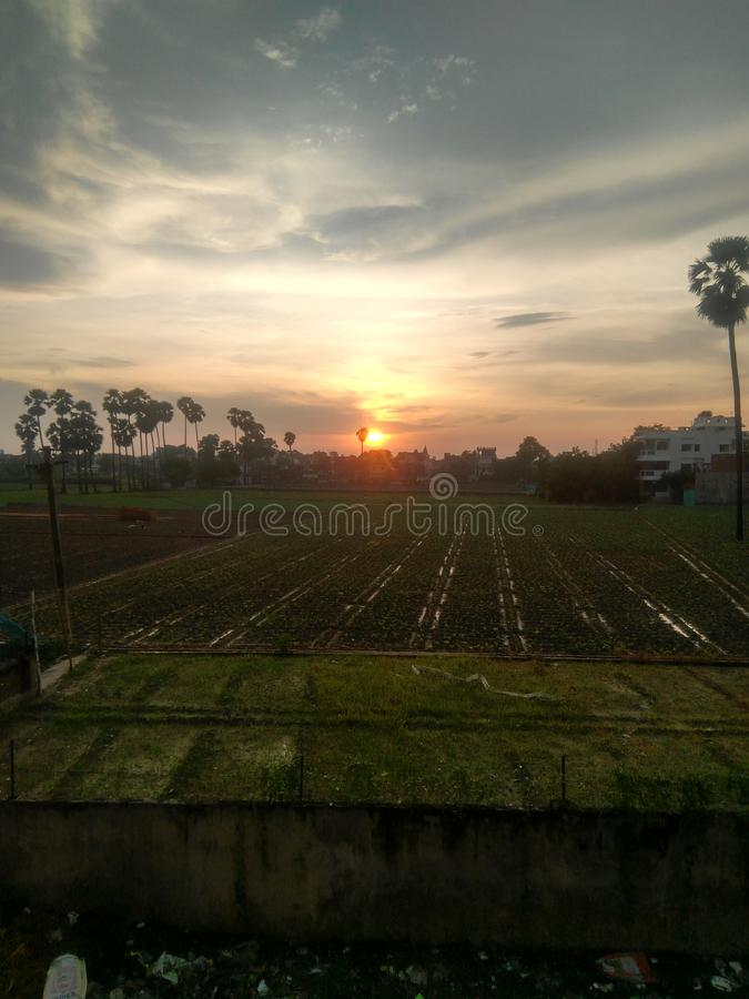 The sunset of beautiful village. This is the picture of sunset at a sub urban town, in this pic you could found that it contains a bulk of houses in front of royalty free stock photo