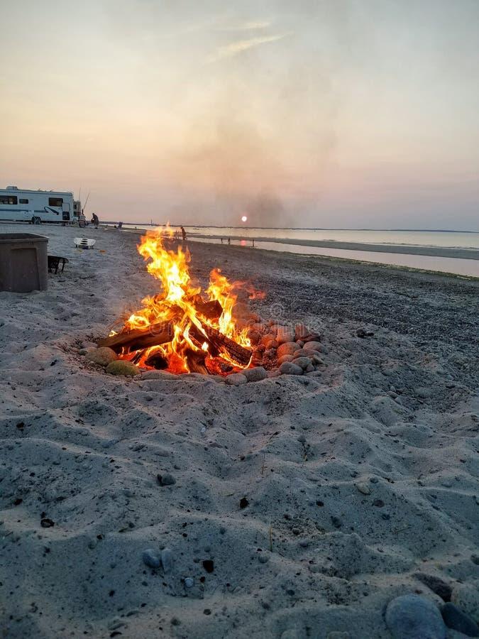 Sunset behind bonfire royalty free stock photography