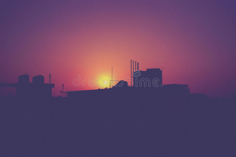 Sunset behind buildings stock photography