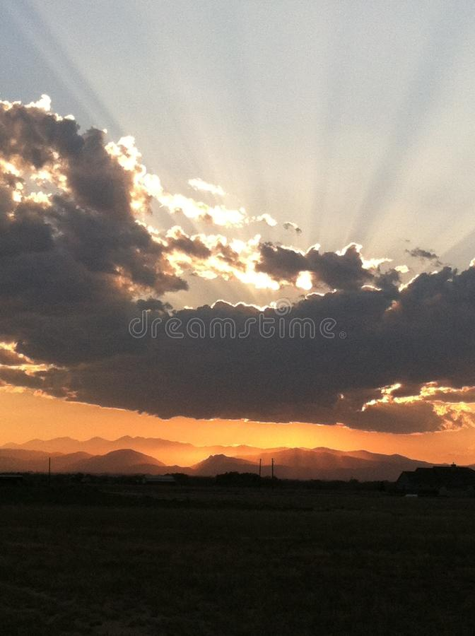 Sunset behind clouds over mountains 4 royalty free stock photography