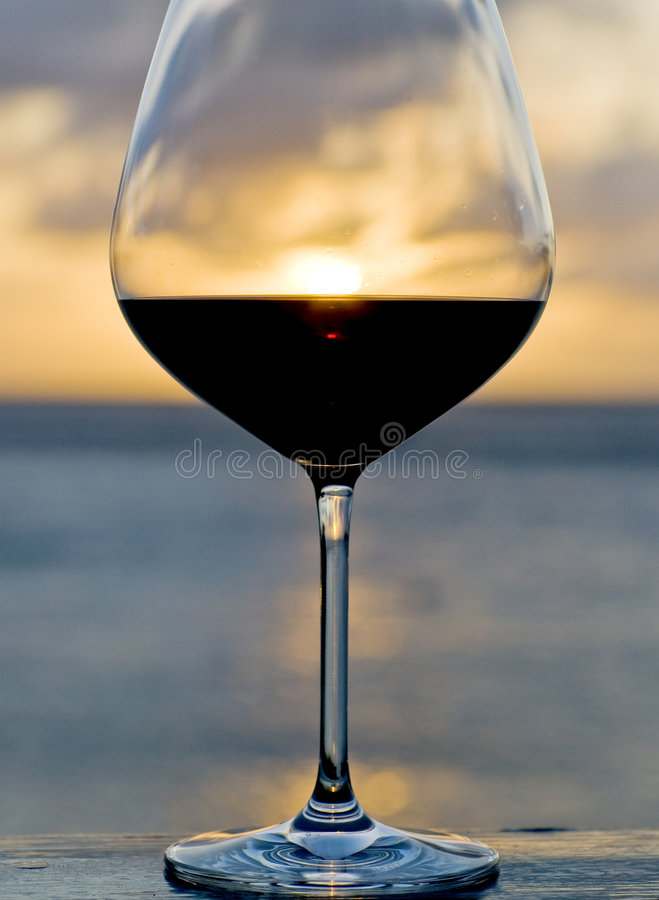 Download Sunset Behind A Glass Of Red Wine Stock Photo - Image: 9184052