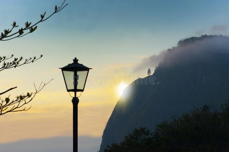 Sunset behind a hill royalty free stock photography