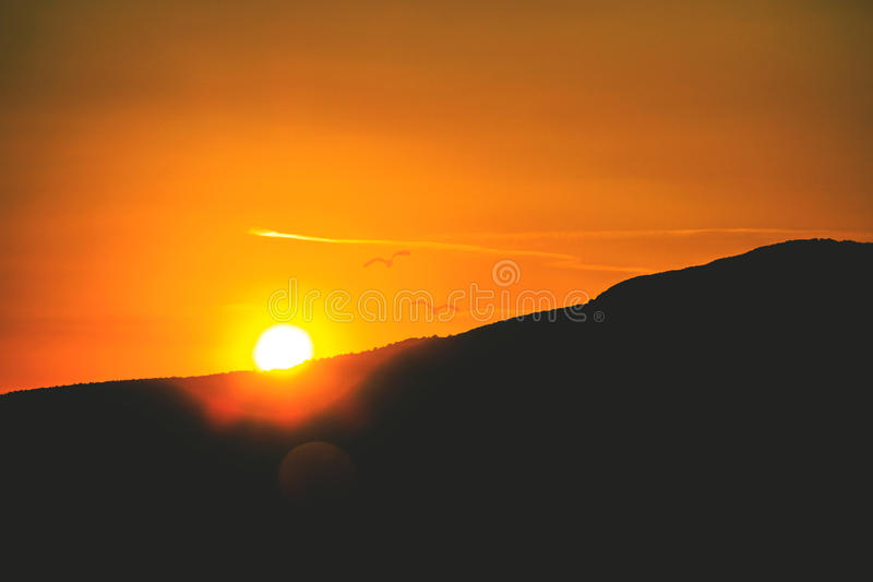 Sunset behind Italian hills royalty free stock photos