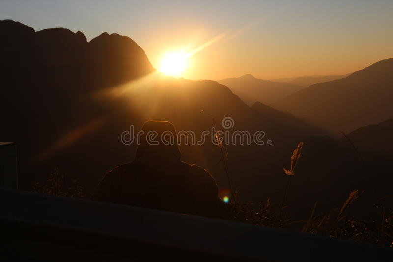 Sunset behind the mountain royalty free stock photography