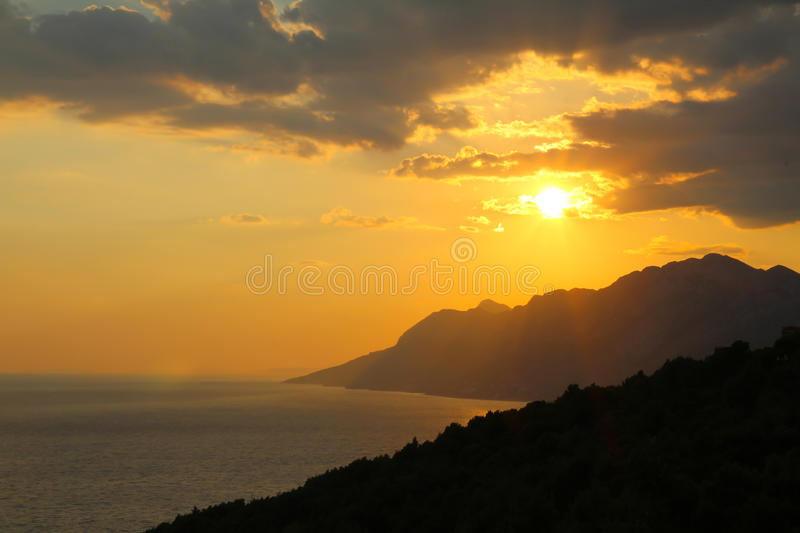 Sunset behind mountains in Croatia royalty free stock photography