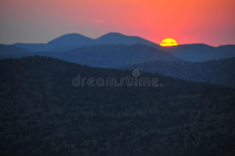 Sunset behind mountains. royalty free stock photography