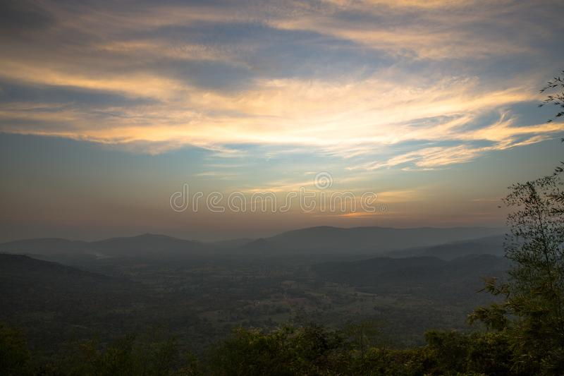 Sunset behind moutain stock images