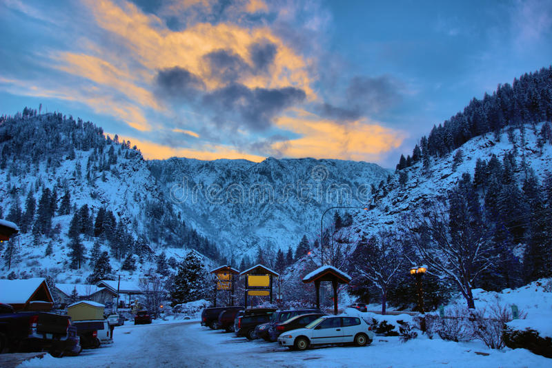 Sunset behind snowy mountain. Beautiful sunset behind snowy mountain in USA royalty free stock photography