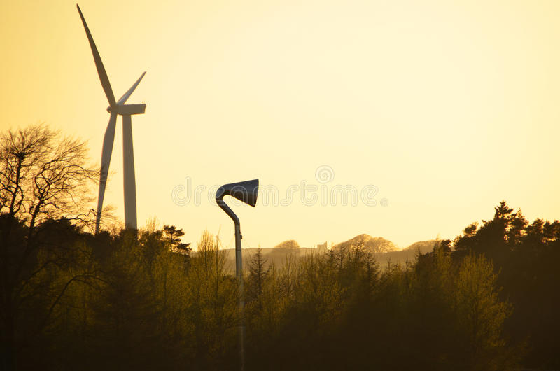 Sunset behind wind turbines royalty free stock photo