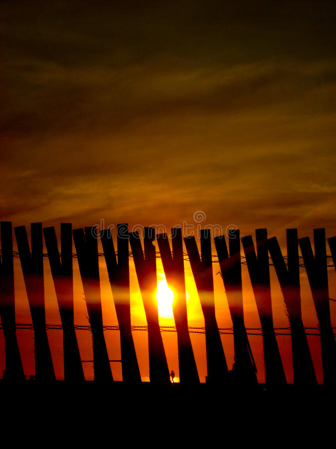 Free Sunset Behind Wooden Fence - Security - Background Royalty Free Stock Photo - 38331255