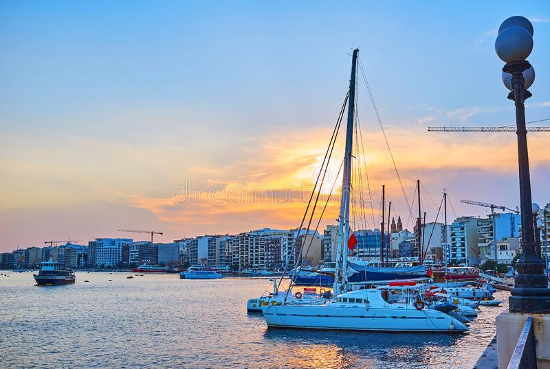 Sunset behind the yachts` sails, Sliema, Malta royalty free stock images