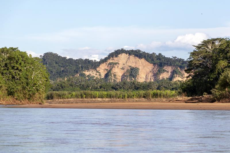 Sunset at Beni river cliffs, adventure in jungles of Madidi national park, Amazon river basin in Bolivia, South America. Sunset at Beni river cliffs during royalty free stock photo