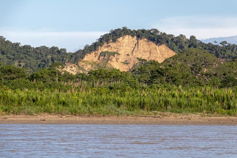 Sunset at Beni river cliffs, adventure in jungles of Madidi national park, Amazon river basin in Bolivia, South America. Sunset at Beni river cliffs during stock image
