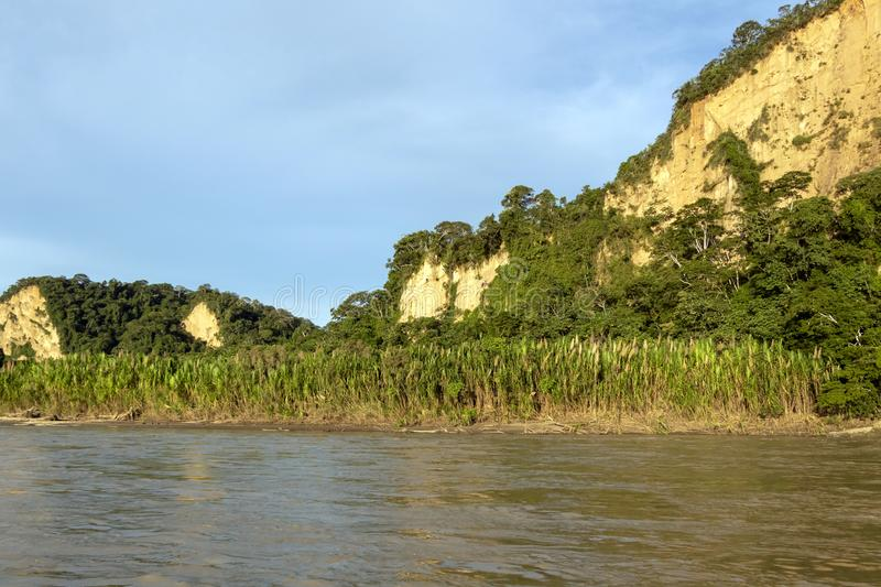 Sunset at Beni river cliffs, adventure in jungles of Madidi national park, Amazon river basin in Bolivia, South America. Sunset at Beni river cliffs during stock photo