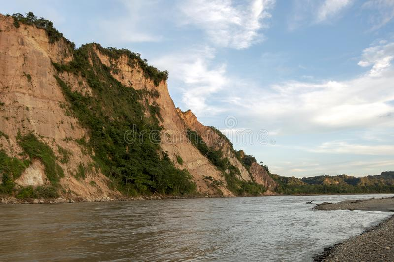 Sunset at Beni river cliffs, adventure in jungles of Madidi national park, Amazon river basin in Bolivia, South America. Sunset at Beni river cliffs during stock photos