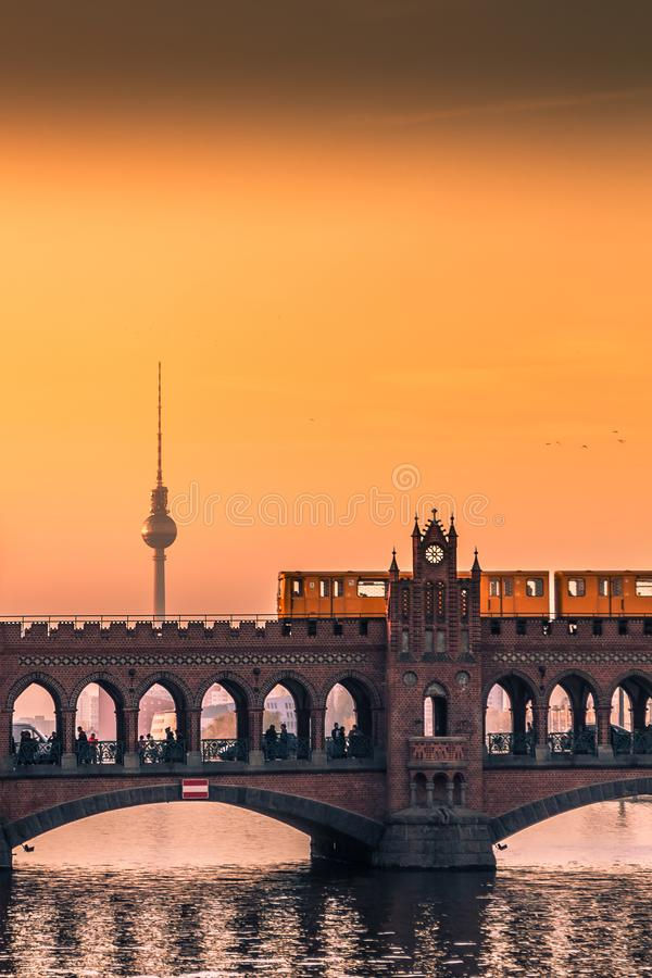 Sunset in Berlin. Oberbaum Bridge in Berlin at Sunset with View on the Television Tower stock photo