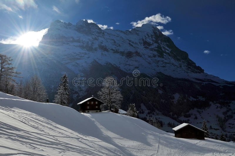Sunset beyond Eiger. Chalets in Grindelwald at sunset - Switzerland royalty free stock photo