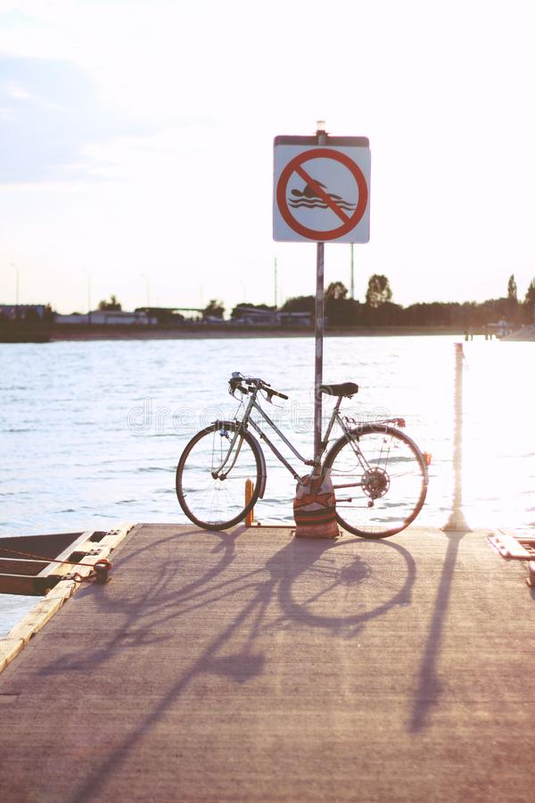 Sunset & bicycle stock images