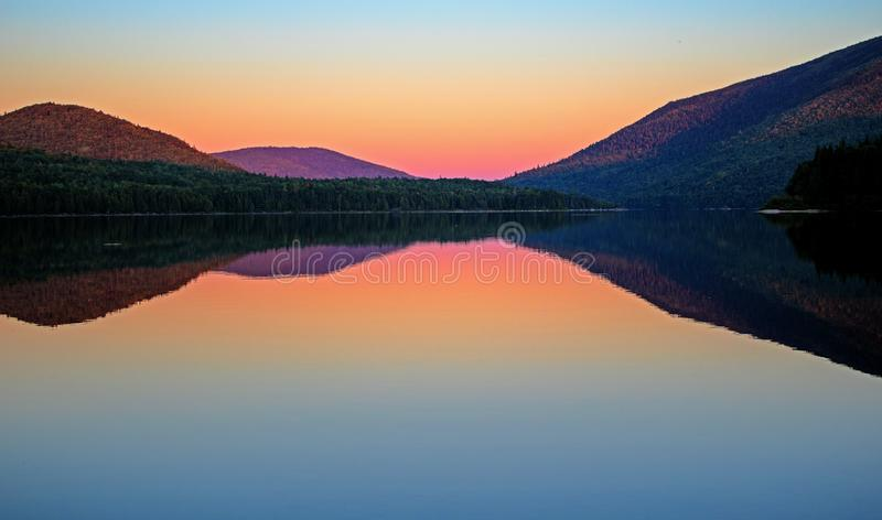 After The Sunset On Big Nictau Lake. Looking across Big Nictau Lake at Mount Sagamook in Mount Carleton Provincial Park. The location is in the wilderness of stock images
